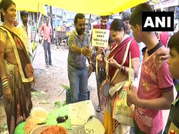 Surendra Bairagi distributing cloth bags in Raipur on Thursday