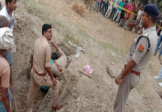 The UP police rescues a girl child after she fell inside a borewell in Banda on Tuesday Photo/ANI