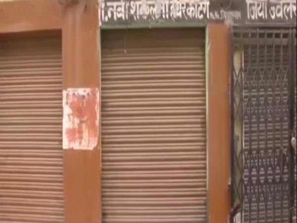Closed barber shops in Pipalsana Bhojpur village of Moradabad. Photo/ANI