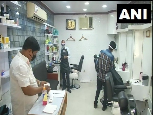 Barber shops, salons reopen in Lucknow. Photo/ANI
