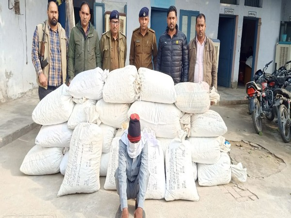 Haryana Police with the arrested individual in Sirsa district on Saturday.