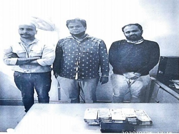 A total of Rs 9,50,000 and three mobile phones have recovered from them, the police said. (ANI)