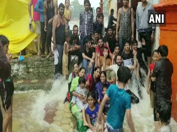 Residents of Multai celebrate as Tapti river overflows after three years and enters Tapti temple. Photo/ANI