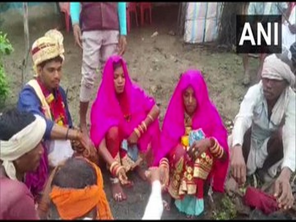 Sandeep Uike while getting married to two women. Photo/ANI