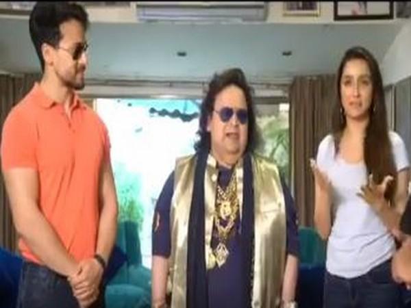Actor Tiger Shroff, musician Bappi Lahiri and actor Shraddha Kapoor (Photo/Twitter)