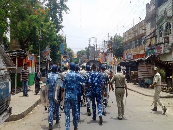 Paramilitary personnel march as a clash broke out between two groups in Bhatpara on June 26.