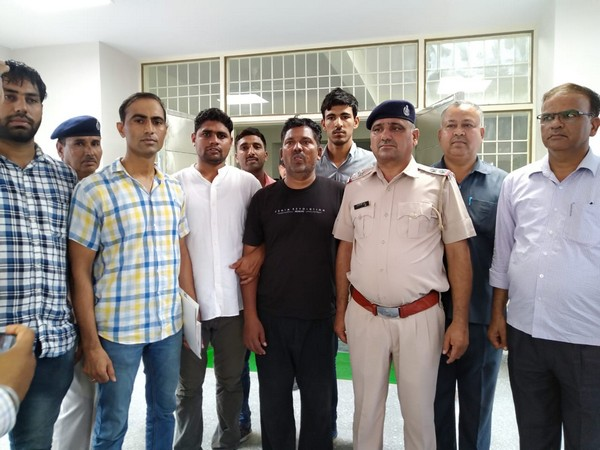 The prime accused in Bhiwani triple murder case arrested with the police team. Photo/ANI