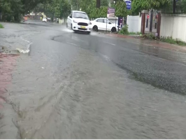 Vehicles ply on waterlogged roads in Bhopal
