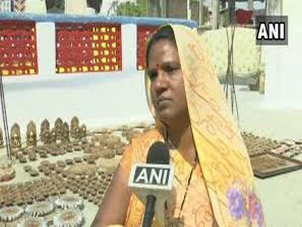 Kavita Yadav tells ANI about cow-dung lamps. (Photo/ANI)