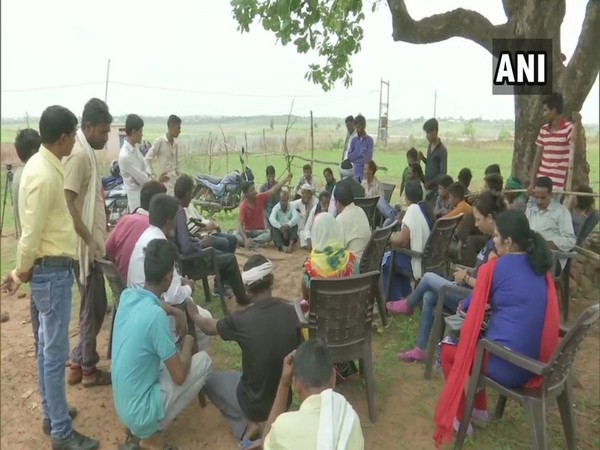 The district authorities while holding a meeting with villagers in Sarotipura village in Bhopal on Thursday. Photo/ANI
