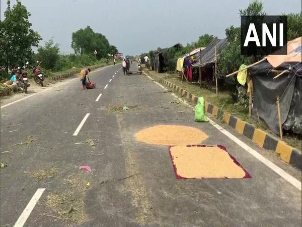 People were forced to set up camps at NH-27 after their homes got partially submerged in floodwaters. (Photo/ANI)