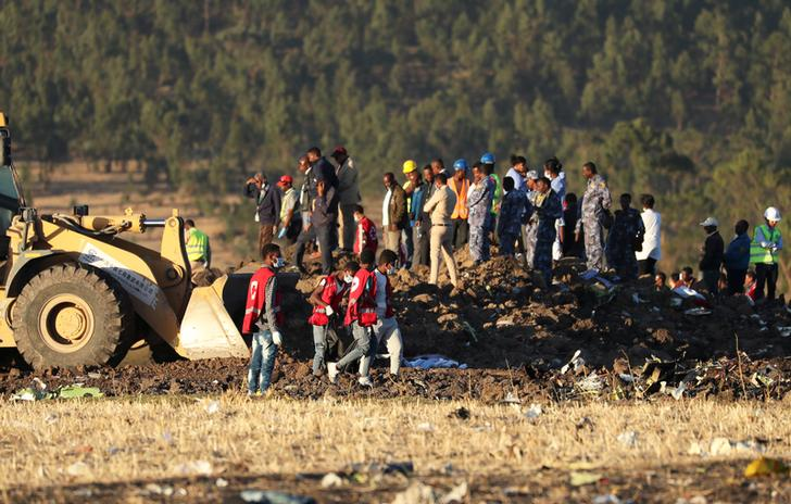 Workers scouring through debris from the site of crash in Bishoftu, Ethiopia on March 10