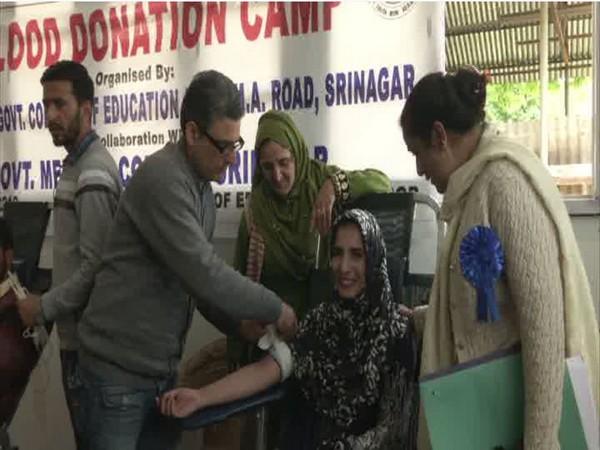 Teen donating blood at B.Ed college in Srinagar [Photo/ANI]