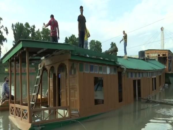 Houseboats in River Jhelum in Srinagar (File Photo/ANI)
