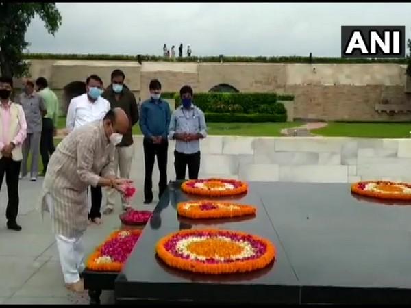 Karnataka Chief Minister Basavaraj Bommai pays tribute to Mahatma Gandhi at Raj Ghat (Photo/ANI)