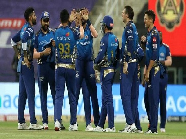 MI players celebrating after taking a wicket. (Image: Mumbai Indians' Twitter)
