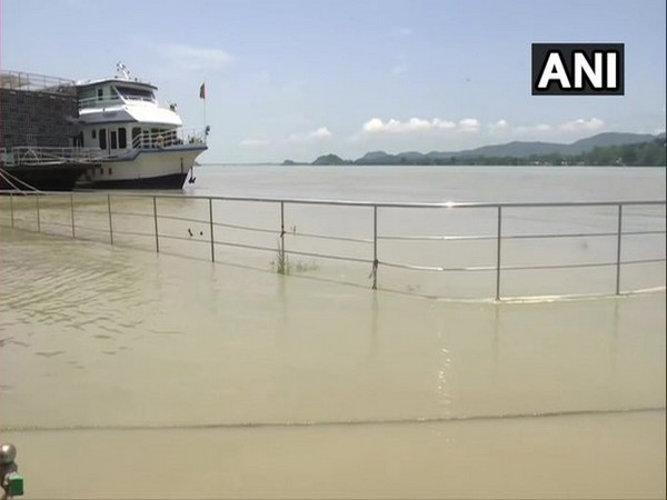 Water level of Brahmaputra river continues to rise in Guwahati, following heavy rainfall. [Photo/ANI]