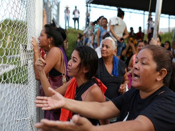 Relatives of inmates react in front of a prison complex in the Brazilian state of Amazonas after prisoners were found strangled to death in four separate jails. (Photo courtesy: Reuters)