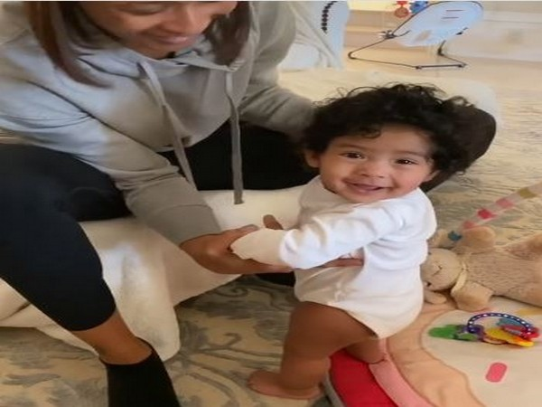 The short clip shows Capri attempting to stand up by herself with a little assistance from her aunt. (Picture courtesy: Instagram)