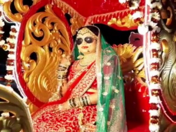 The bride was seen sitting on a chariot in her wedding saree, while donning a pair of sunglasses (Picture Courtesy: ANI)