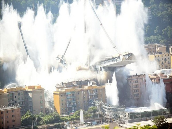 Controlled explosions demolish two of the pylons of the Morandi bridge on Friday