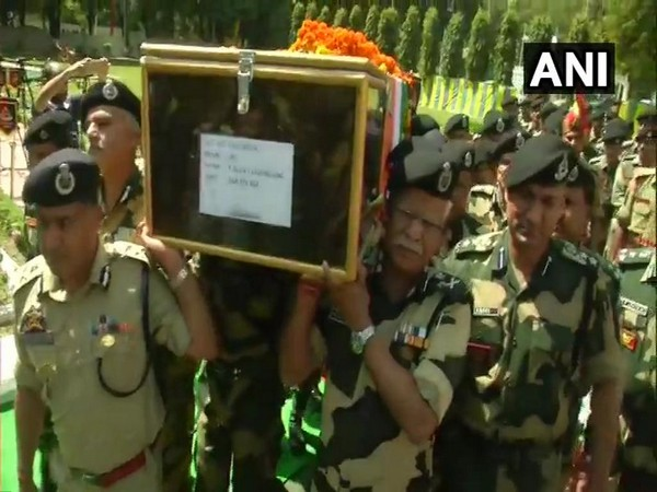 DG RK Mishra and other BSF personnel lending a shoulder to the mortal remains of the soldier on Tuesday. Photo: ANI