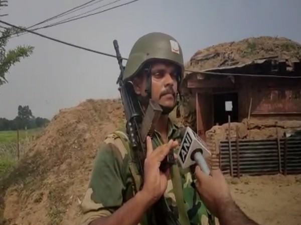 BSF man in Jammu patrolling the international borders [Photo/ANI]