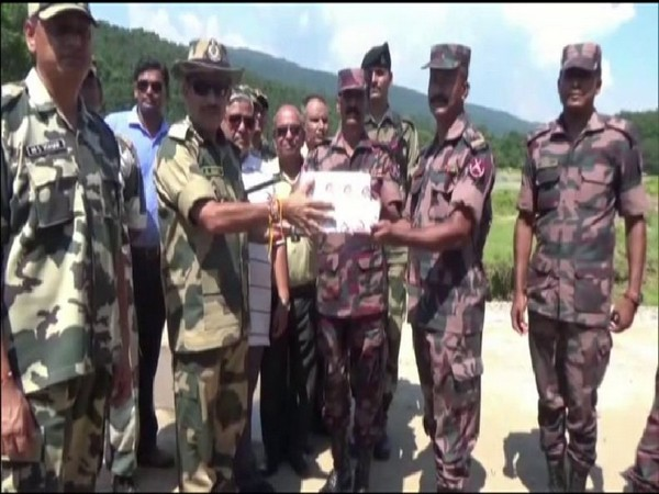 BSF and BGB personnel exchanging sweets on the eve of Bakrid along Meghalaya border. (Photo/ANI)