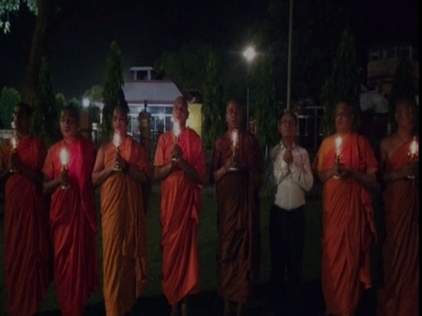 Buddhist monk took out a candlelight march for the victims of serial bombing in Sri Lanka at Bodh Gaya on Sunday