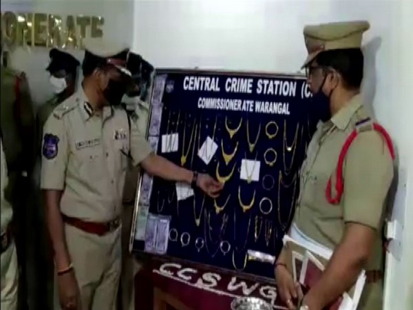 Police officials showing gold ornaments recovered from the possession of House Burglar. (Photo/ANI)