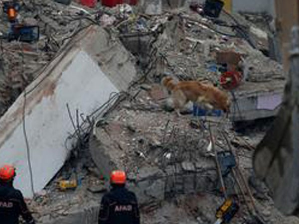 Rescue workers at the site of the building collapse in Istanbul, Turkey