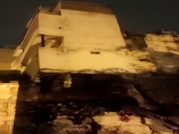 Visual of building with collapsed foundation and safety wall (Photo/ANI)