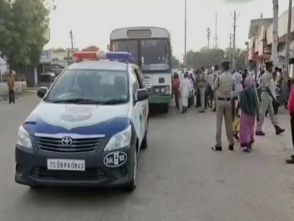 Bus services operated with police escort in Gadwal city [Photo/ANI]