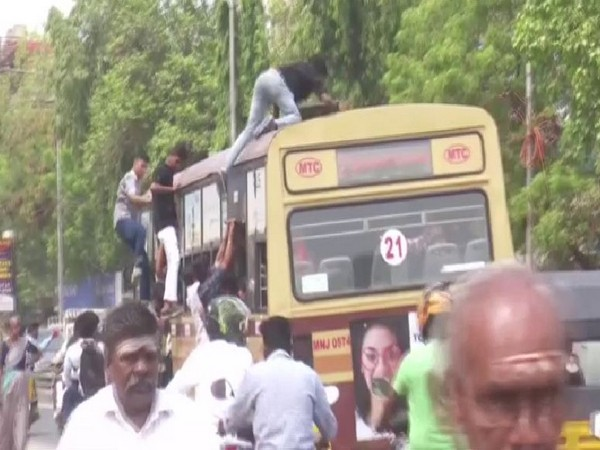 Students atop a bus during the 'Bus Day' celebrations (Photo/ANI)