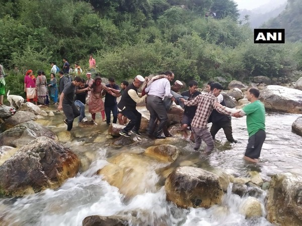 Passangers being rescued after their bus fell into a deep george in Kull in Himachal Pradesh on Thursday. (Photo/ANI)