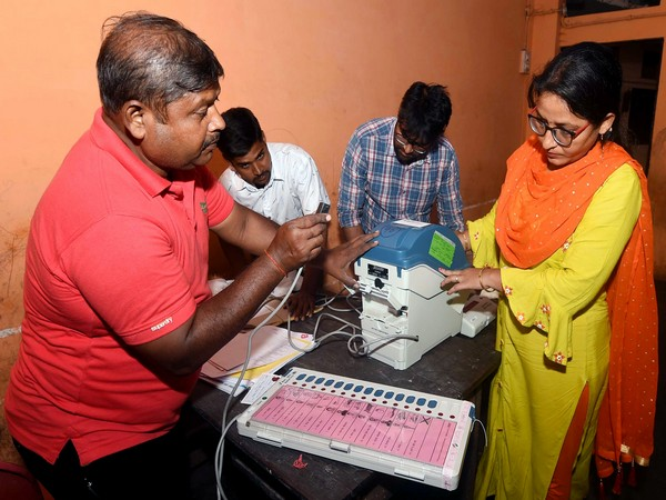 Uttar Pradesh, Oct 20 (ANI): Polling officials setting up EVMs and polling materials at a polling booth on the eve of bye-elections in Lucknow Cantt on Sunday.