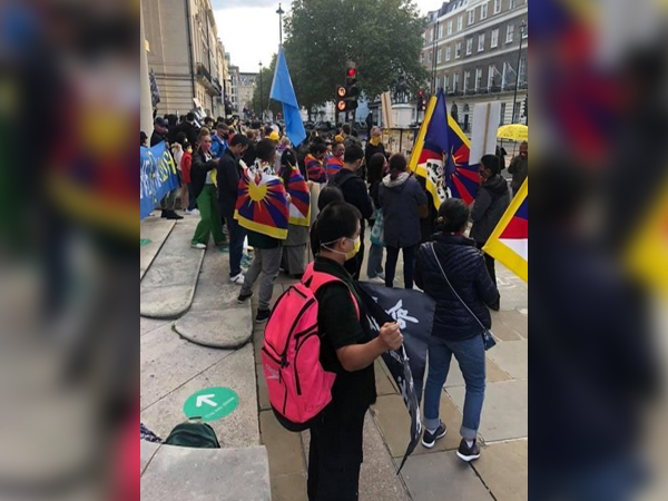 Some of the banners read: 'Free Hong Kong', 'Free Tibet' and 'China Closed the Uyghur Camps'