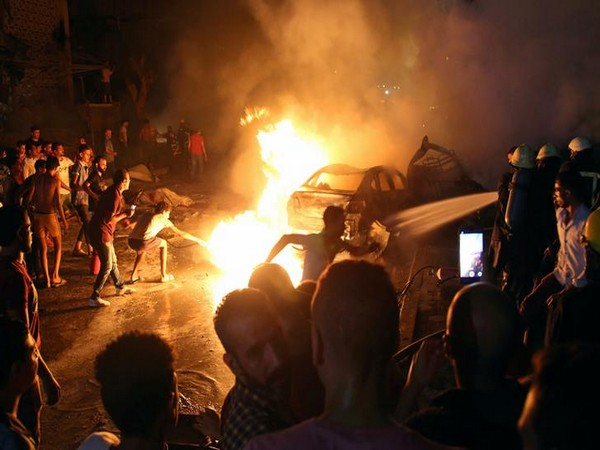 People extinguishing the flames after cars collided in Cairo on Aug 5 (Photo/Reuters)
