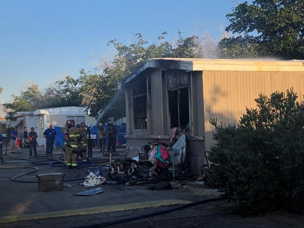 Firefighters work on extinguishing a fire after an earthquake in Ridgecrest in California.