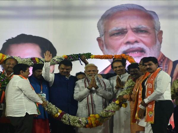 A picture of Prime Minister Narendra Modi along with Chief Minister Devendra Fadnavis and Shiv Sena chief Uddhav Thackeray during poll campaigning in Maharashtra. Photo/ANI (File photo)