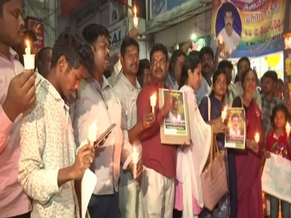 RTC employees carry out a candlelight march from Musheerabad depot to Ram Nagar Circle in Hyderabad on Sunday. Photo/ANI