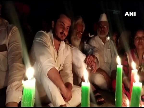 A visual from the candlelight protest held by Samajwadi Party MLA Abdullah Azam Khan on Wednesday. (Photo/ANI)
