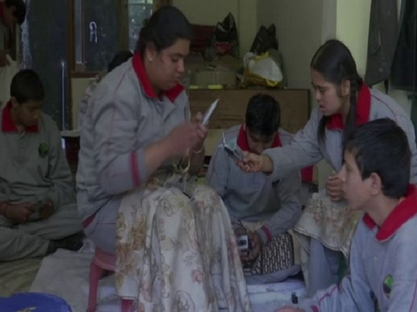 Specially abled children of Udaan Special School of New Shimla making candles for Diwali. Photo/ANI