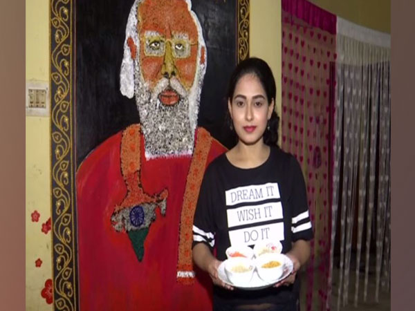 Priyanka Sahani with Prime Minister Narendra Modi's portrait (Photo/ANI)
