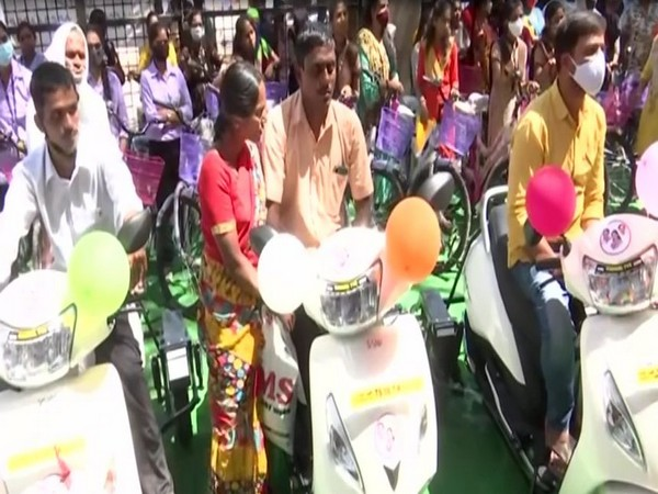 Bicycles to girls and motor vehicles to the specially-abled were distributed on MLC K Kavitha's birthday on Saturday. [Photo/ANI]
