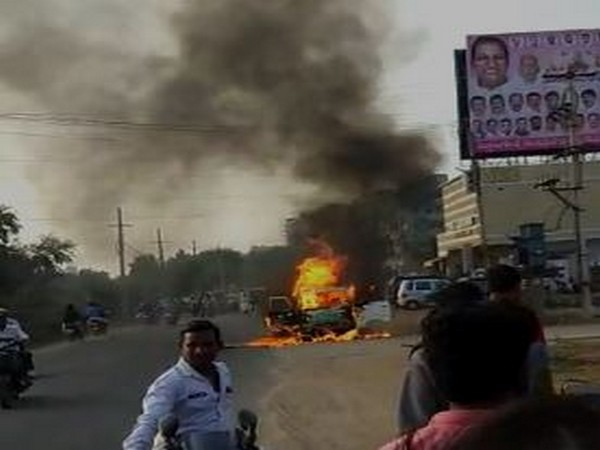 A moving car caught fire in Ranga Reddy, Telangana. Photo/ANI