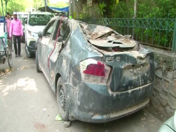 The car that got badly damaged after the 18th Century gate collapsed. Photo/ANI