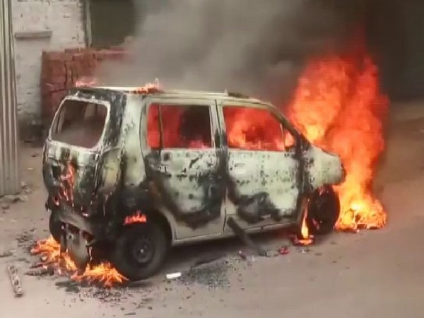 A moving car caught fire in Lucknow on Thursday. Photo/ANI