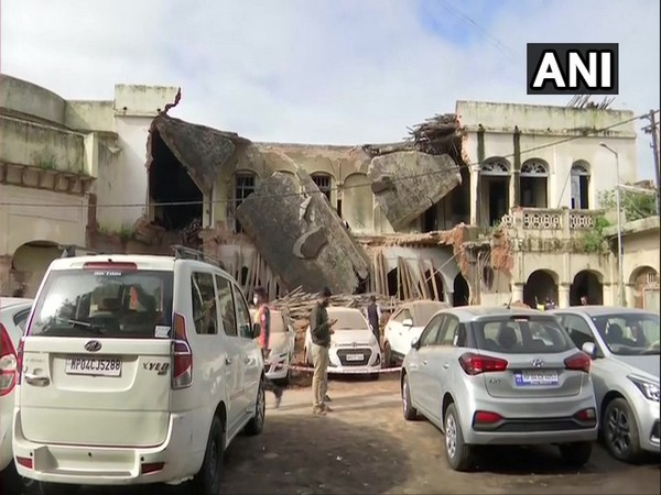 Several vehicles were damaged after parts of an old building collapsed in a parking area in Bhopal. (Photo/ANI)