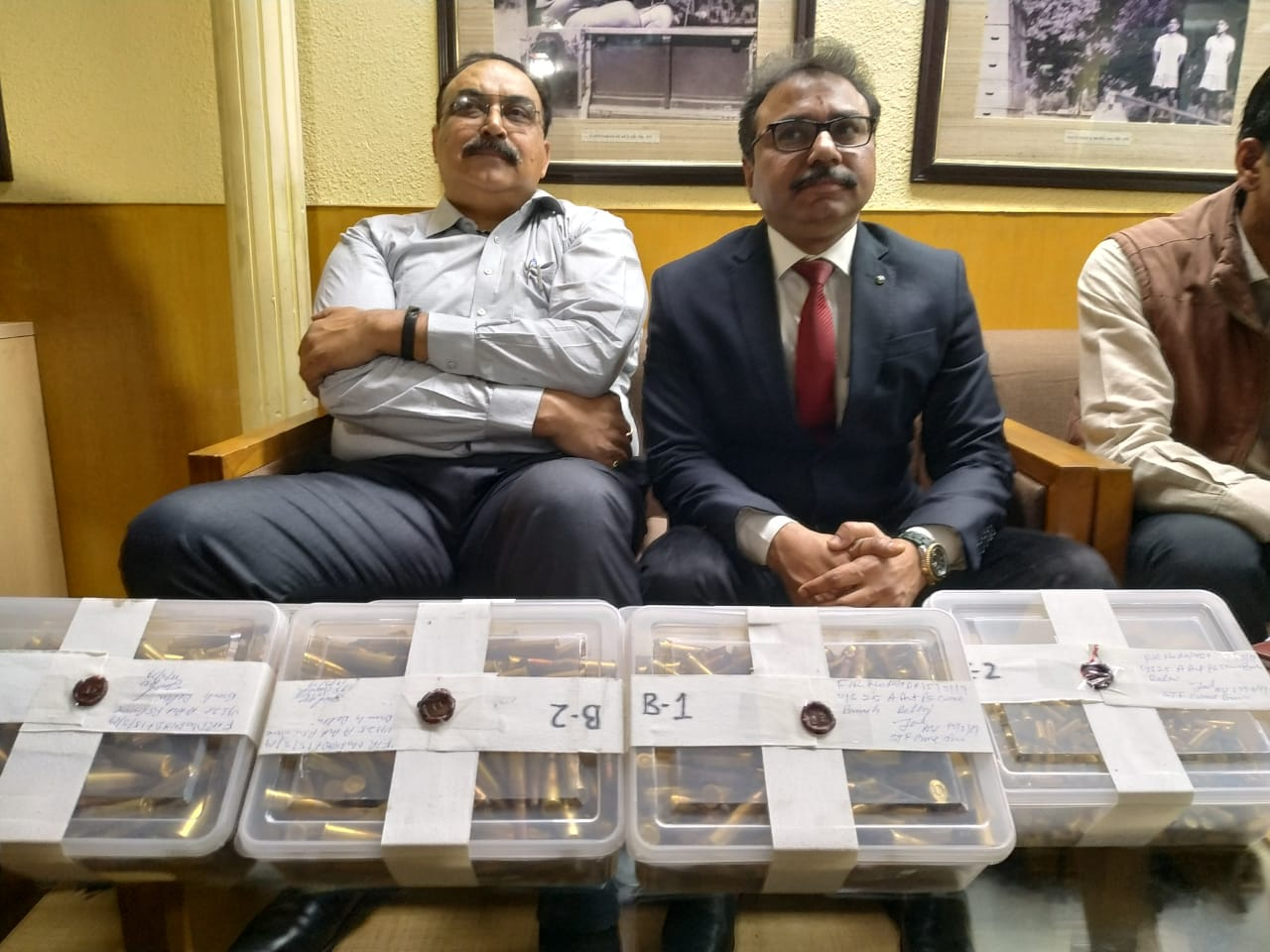 Police officials including Ram Gopal Naik (Center) with the 2000 seized live cartridges in New Delhi on Saturday.